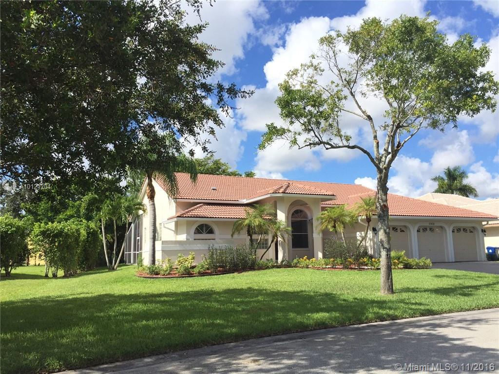 Photo of home for sale at 10402 51st St NW, Coral Springs FL