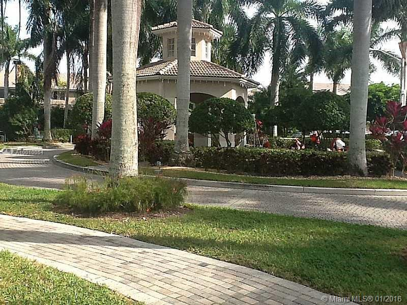 Photo of home for sale at 5713 114 ct NW, Doral FL