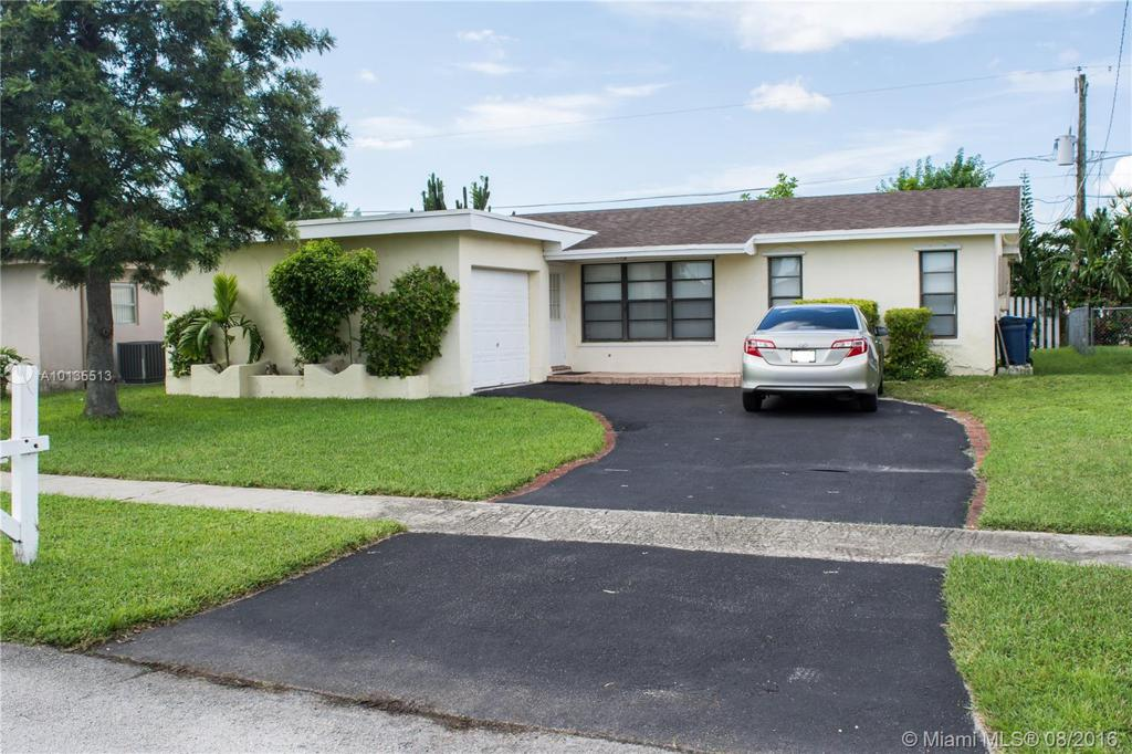 Photo of home for sale at 11731 30th Pl NW, Sunrise FL