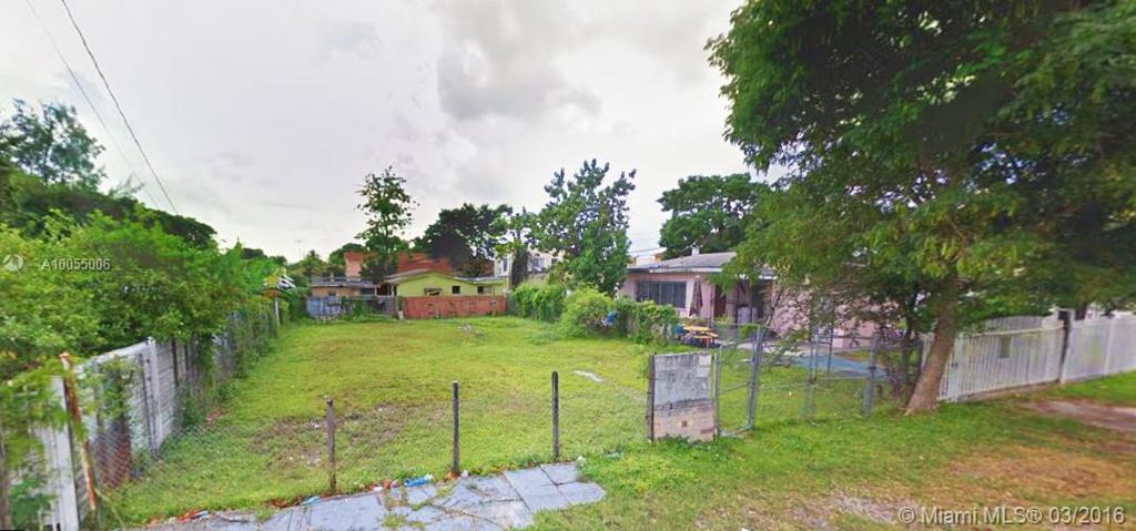 Photo of home for sale at 786 31st St NW, Miami FL