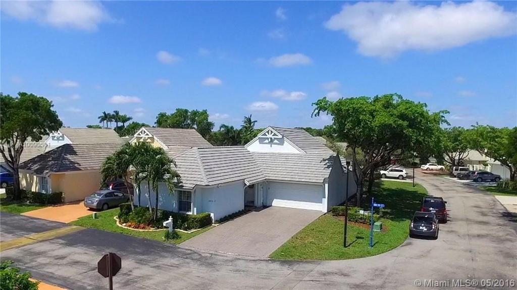 Photo of home for sale at 4870 99th Ct NW, Doral FL