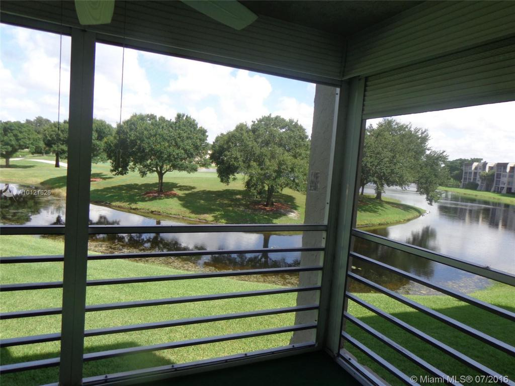 Photo of home for sale at 9470 Poinciana Pl, Davie FL