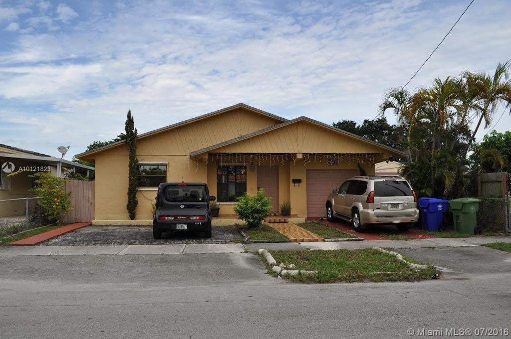 Photo of home for sale at 201 48th Ct NW, Miami FL