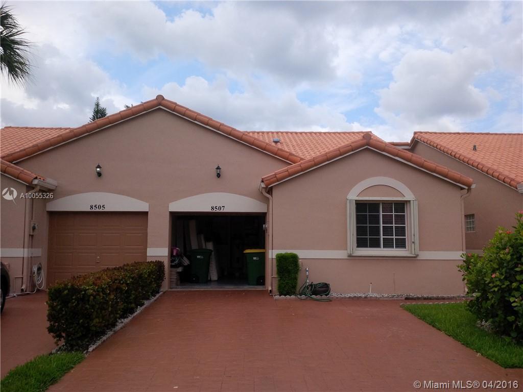 Photo of home for sale at 8507 Cherry Blossom LN, Tamarac FL