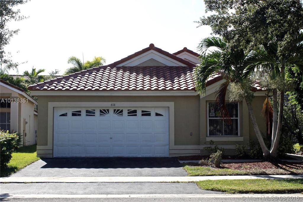 Photo of home for sale at 616 Stanton Dr, Weston FL