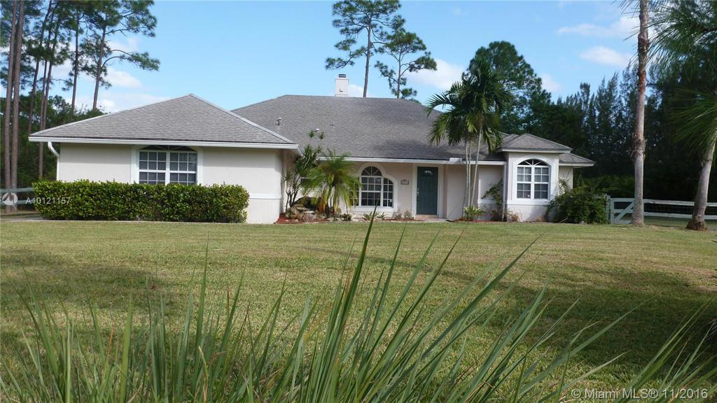 Photo of home for sale at 7784 Hall Blvd, Loxahatchee FL
