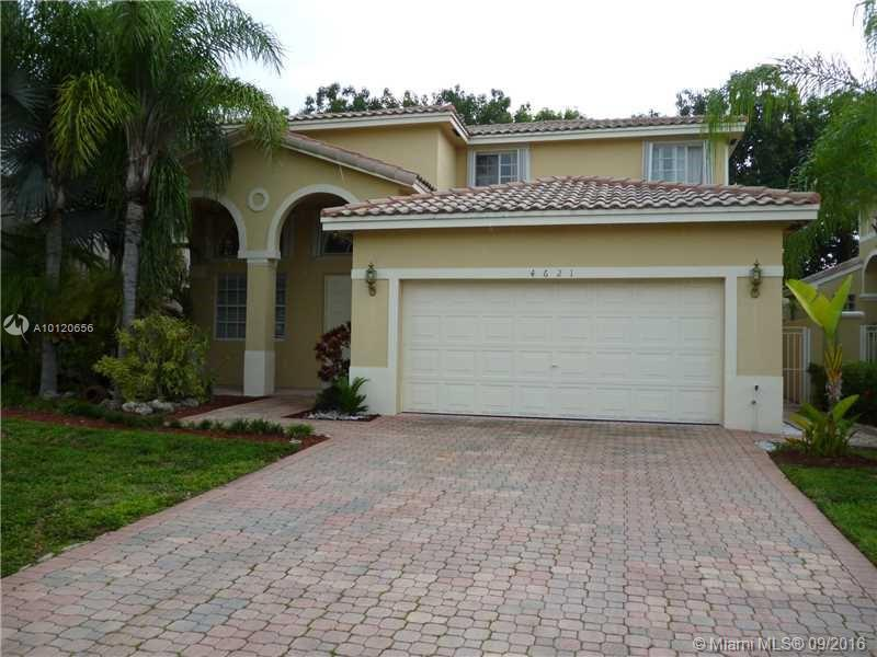 Photo of home for sale at 4621 94 CT NW, Doral FL