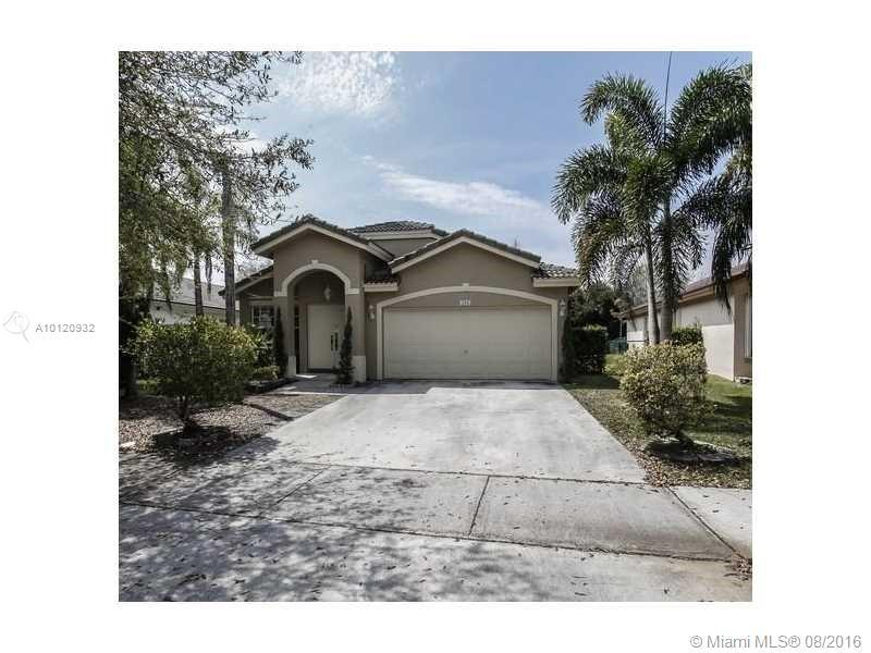 Photo of home for sale at 386 206 AVE SW, Pembroke Pines FL