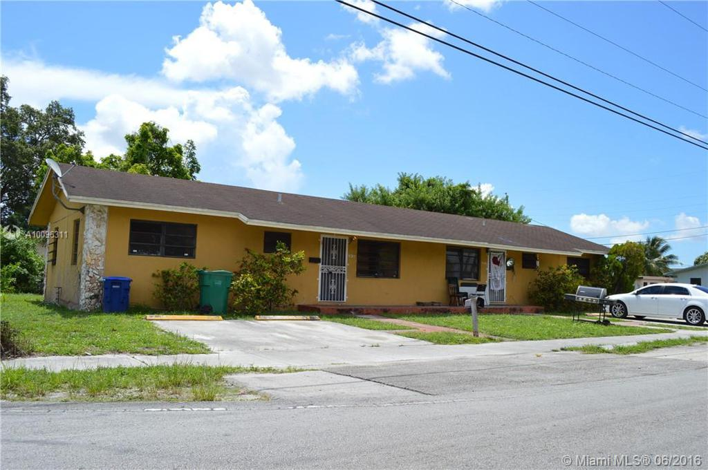 Photo of home for sale at 8595 25th Ave NW, Miami FL