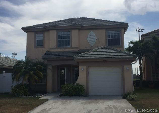 Photo of home for sale at 6086 Spring Isles Blvd, Lake Worth FL