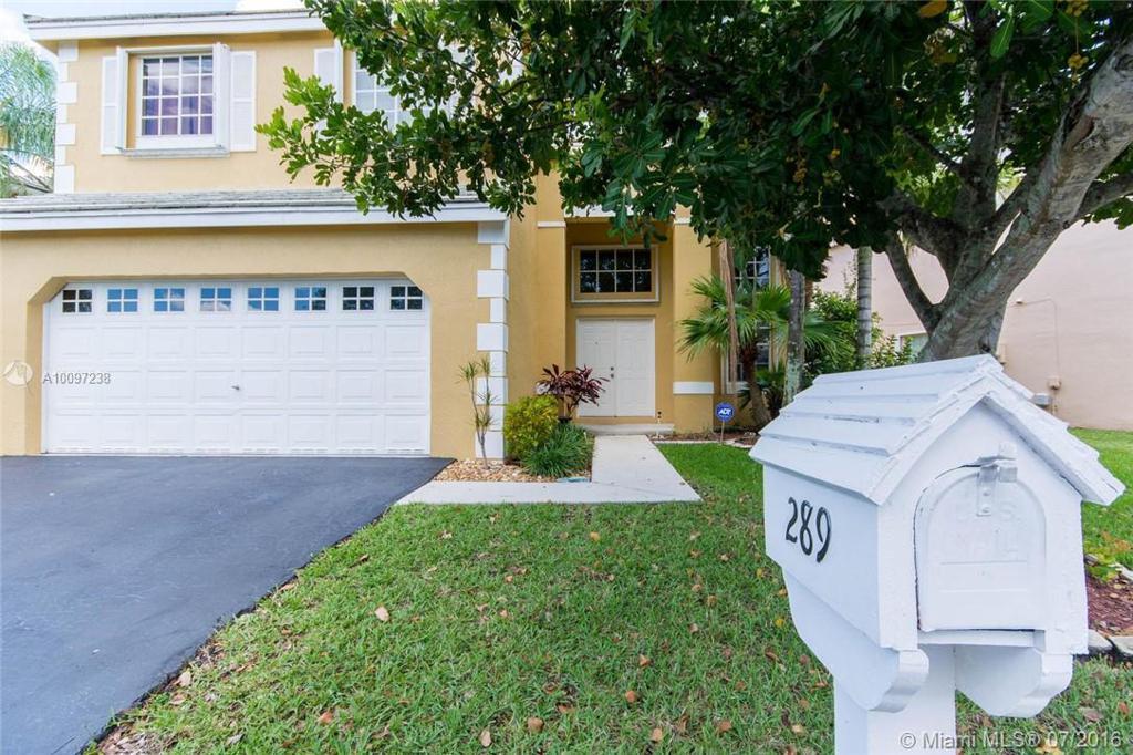 Photo of home for sale at 289 Bridgeton Way NW, Weston FL