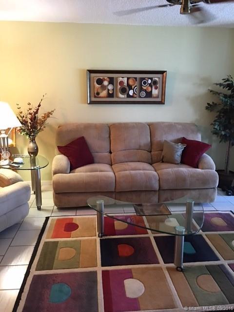 Photo of home for sale at 7706 Tahiti Ln, Lake Worth FL