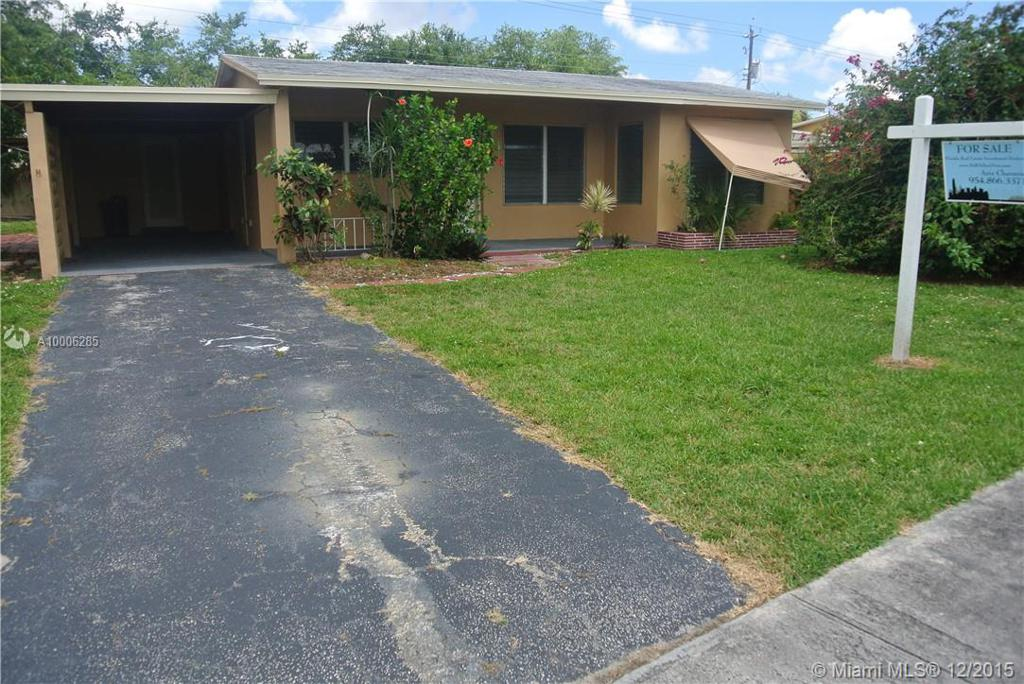 Photo of home for sale at 1608 58th Ave NW, Margate FL