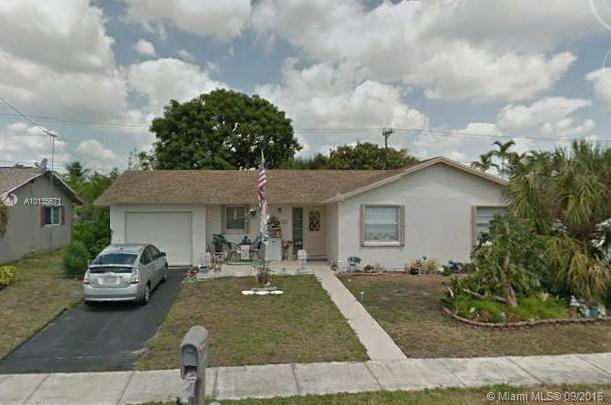 Photo of home for sale at 8321 44th Ct NW, Lauderhill FL