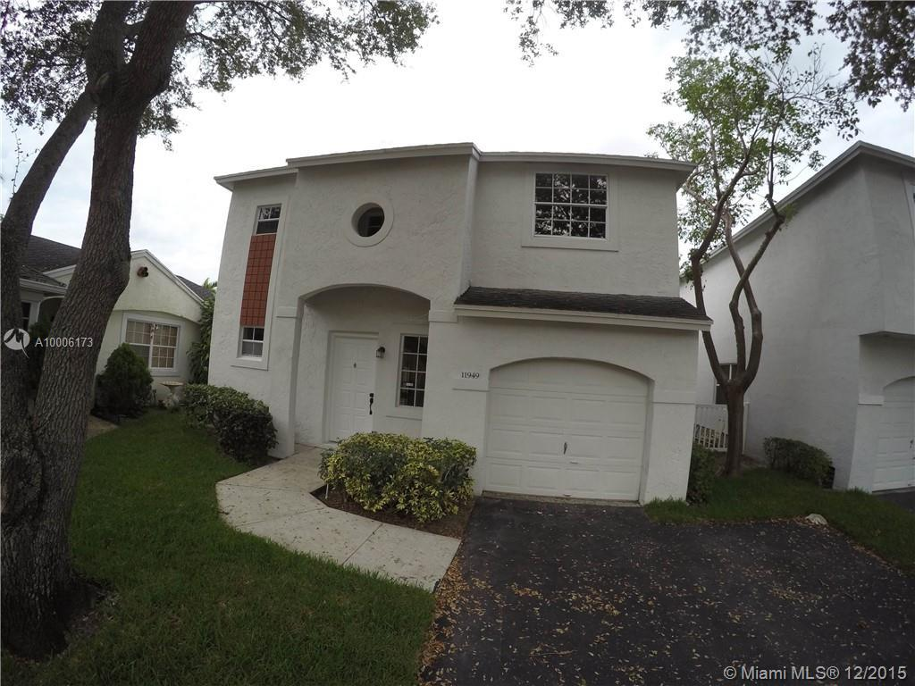 Photo of home for sale at 11949 12 NW, Pembroke Pines FL