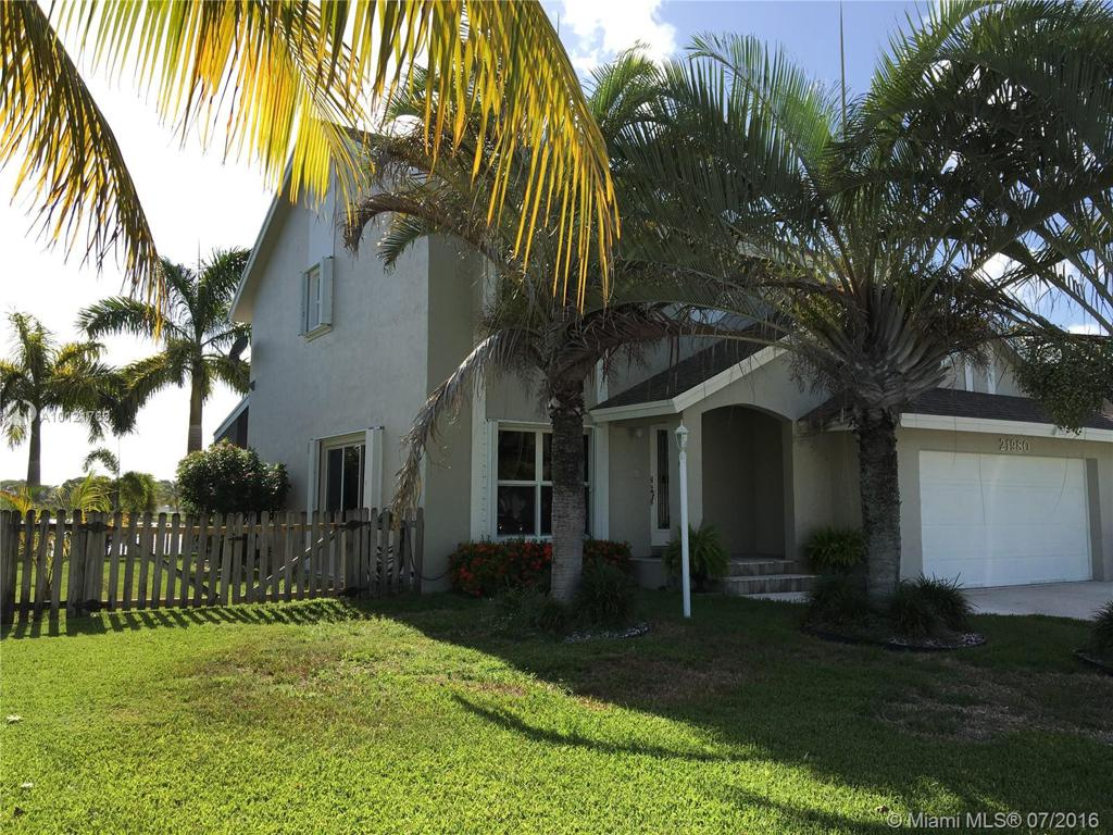 Photo of home for sale at 21980 98 Ave SW, Cutler Bay FL