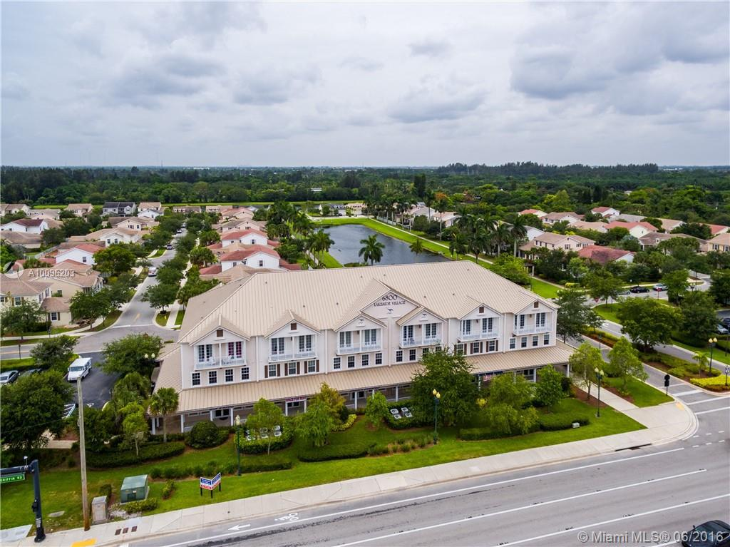 Photo of home for sale at 6840 Griffin Rd, Davie FL