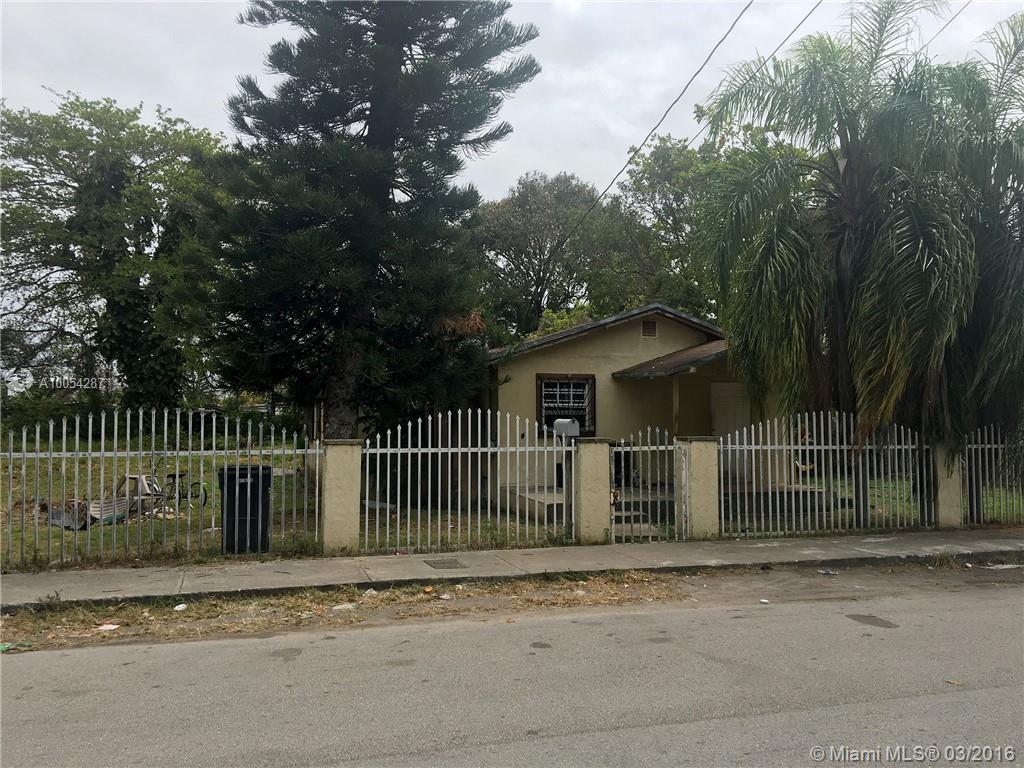 Photo of home for sale at 8011 1st Pl NW, Miami FL