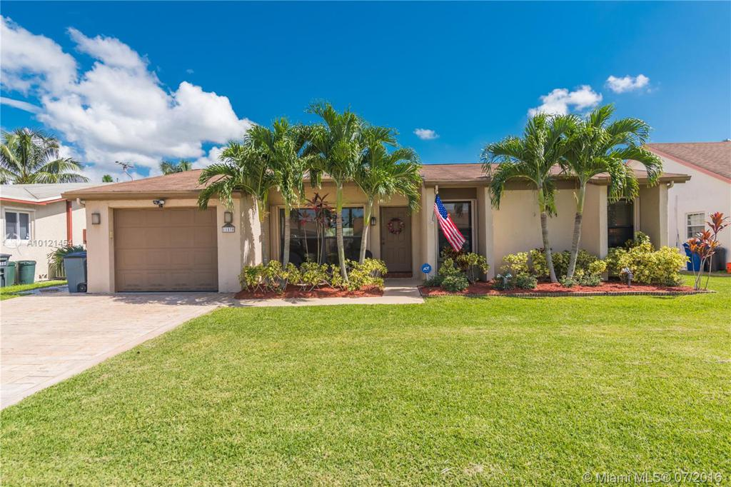 Photo of home for sale at 11830 39th St NW, Sunrise FL