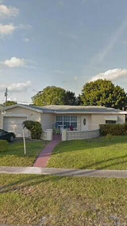 Photo of home for sale at 3457 32nd Ct NW, Lauderdale Lakes FL