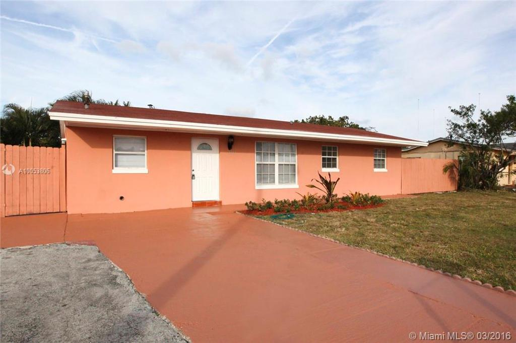Photo of home for sale at 4361 207th Dr NW, Miami Gardens FL