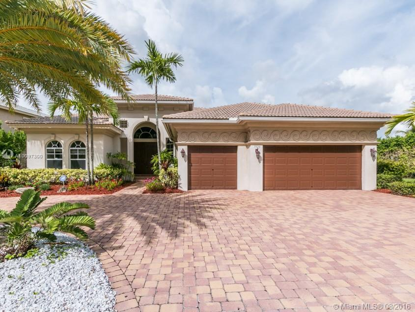 Photo of home for sale at 7523 116th Ln NW, Parkland FL