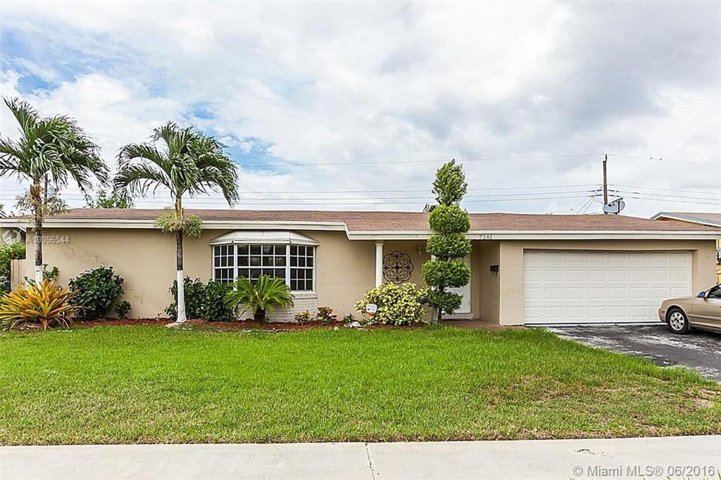 Photo of home for sale at 7161 21st Ct NW, Sunrise FL