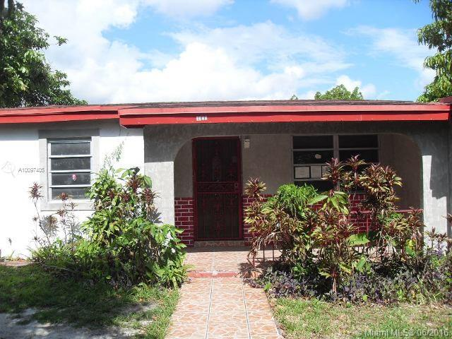 Photo of home for sale at 18220 3rd Ave NW, Miami Gardens FL