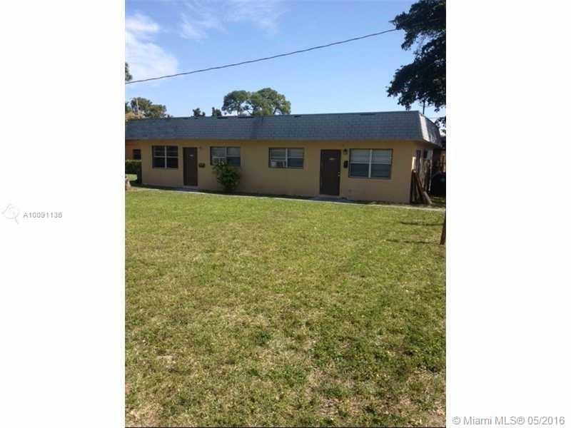 Photo of home for sale at 893 39th street NE, Oakland Park FL
