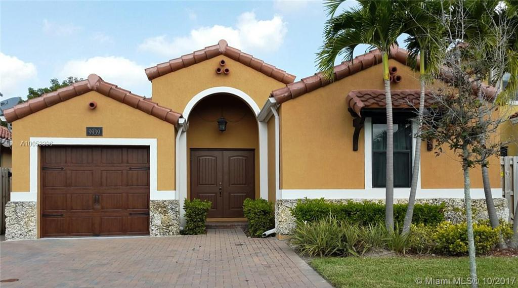 Photo of home for sale at 9939 10th Ter NW, Miami FL