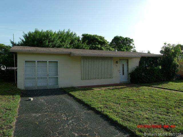 Photo of home for sale at 6661 25th St NW, Sunrise FL