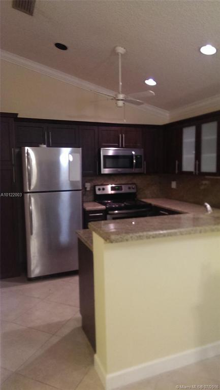 Photo of home for sale at 211 95th Ter SW, Pembroke Pines FL