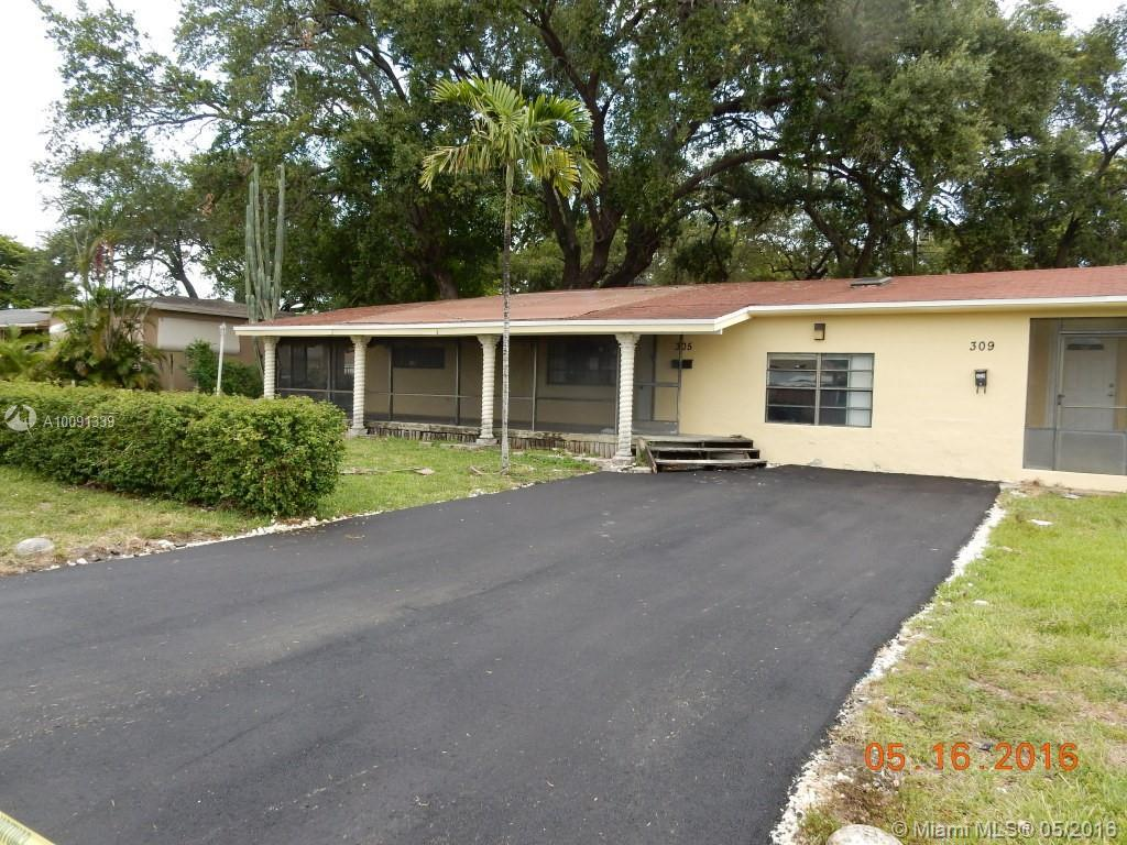 Photo of home for sale at 305 4th Ter SW, Hallandale FL