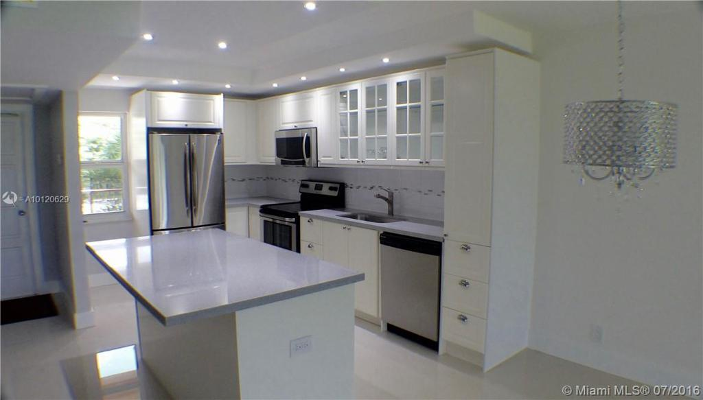 Photo of home for sale at 3001 Course Dr S, Pompano Beach FL