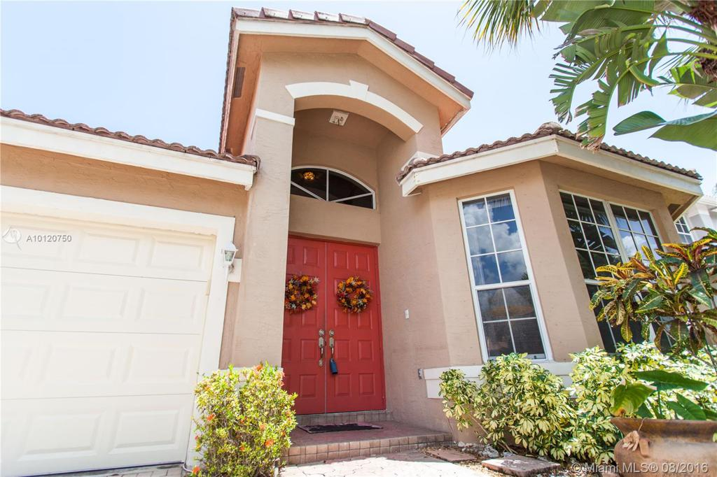 Photo of home for sale at 11851 54th Pl NW, Coral Springs FL