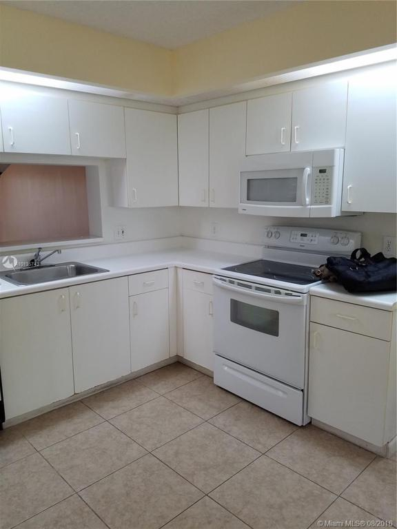 Photo of home for sale at 701 142 SW, Pembroke Pines FL