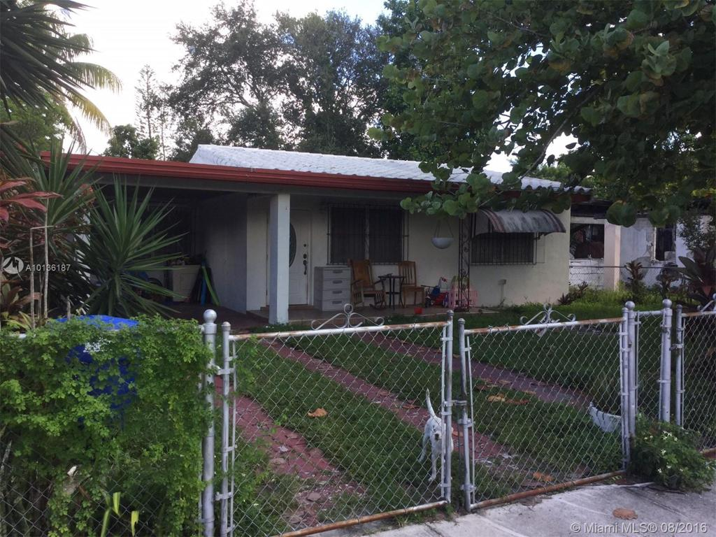 Photo of home for sale at 1765 114th St NW, Miami FL