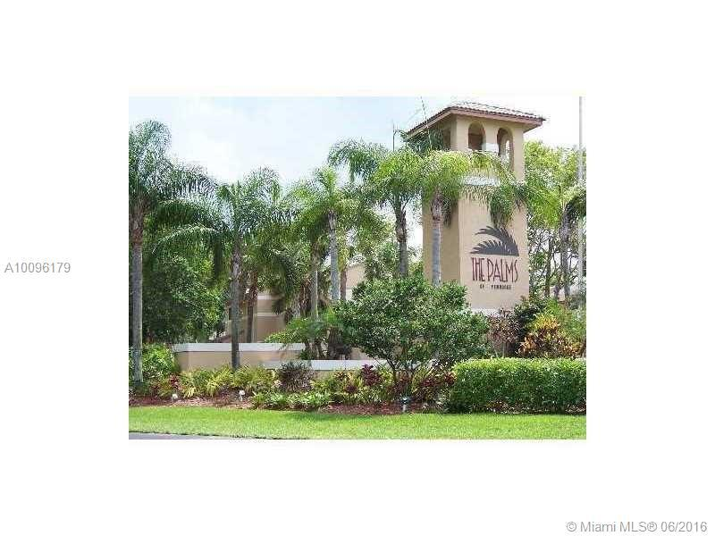 Photo of home for sale at 304 Palm Cir, Pembroke Pines FL