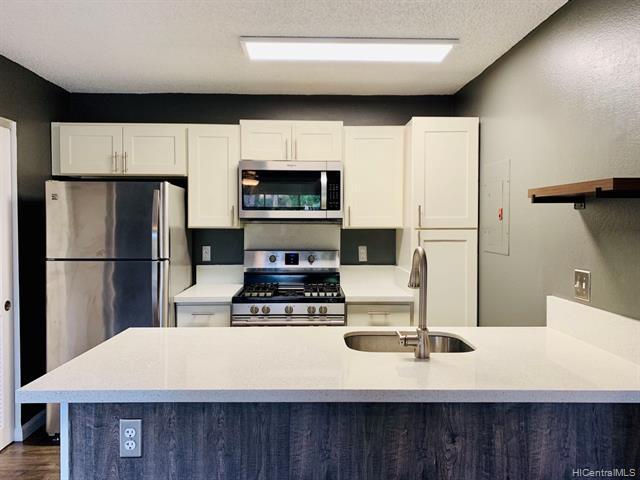 Photo of home for sale at 91-1050 Puamaeole Street, Ewa Beach HI