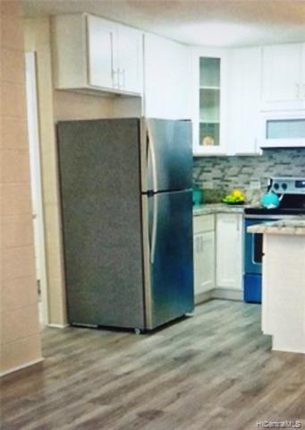 Photo of home for sale at 94-099 Waipahu Street, Waipahu HI