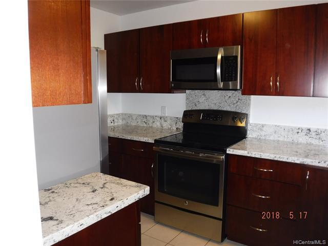 Photo of home for sale at 98-1369 Koaheahe Place, Pearl City HI