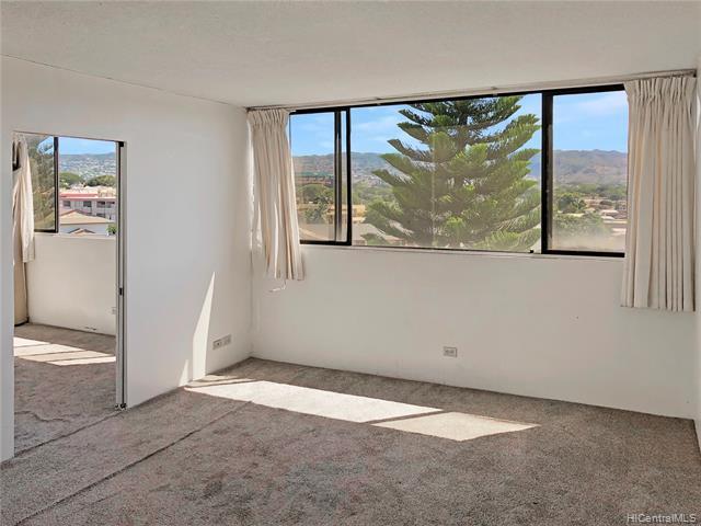 Photo of home for sale at 99-015 Kalaloa Street, Aiea HI