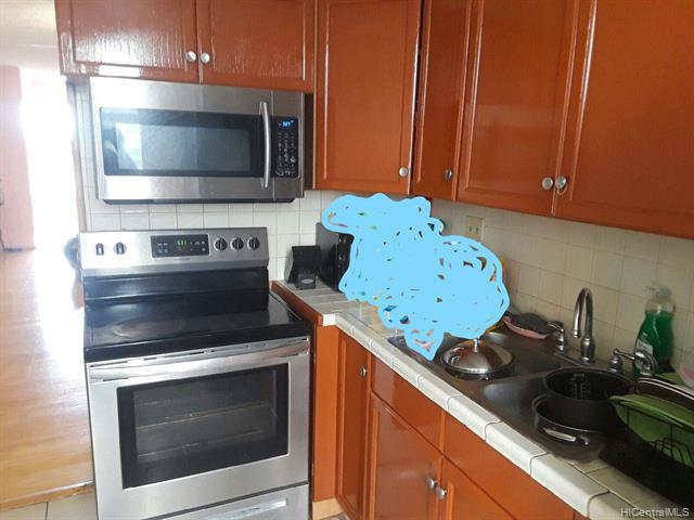 Photo of home for sale at 94-246 Leoku Street, Waipahu HI