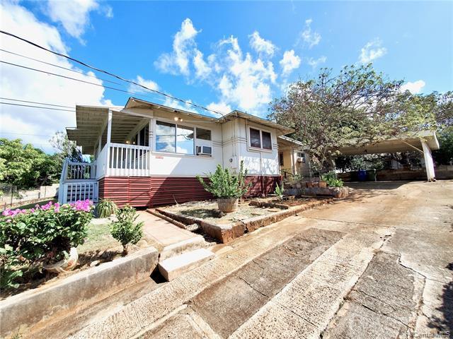 Photo of home for sale at 98-147 Honomanu Street, Aiea HI