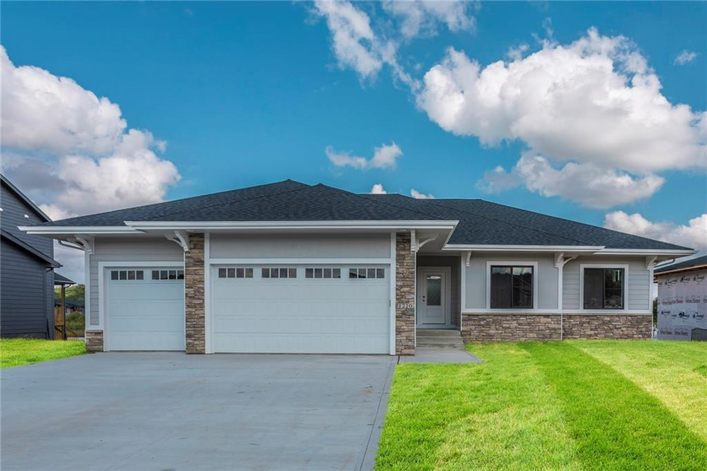 Photo of home for sale at 1220 100th Street S, West Des Moines IA