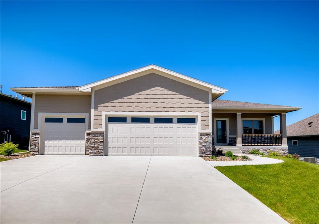 Photo of home for sale at 1421 Arrowleaf Lane S, West Des Moines IA