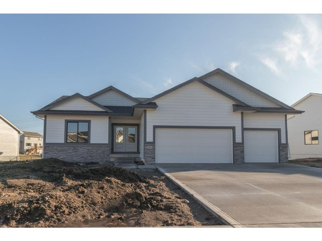 Photo of home for sale at 14824 Coyote Drive, Urbandale IA