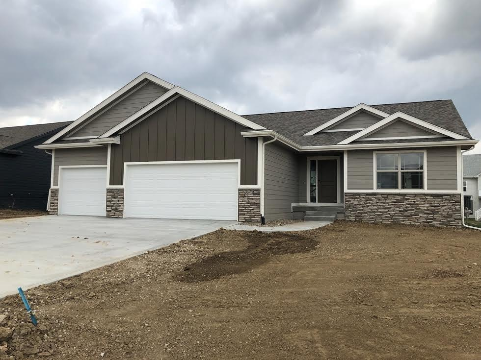 Photo of home for sale at 850 Lost Lake Drive, Polk City IA