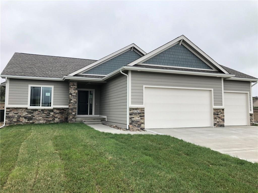 Photo of home for sale at 1541 100th Street S, West Des Moines IA
