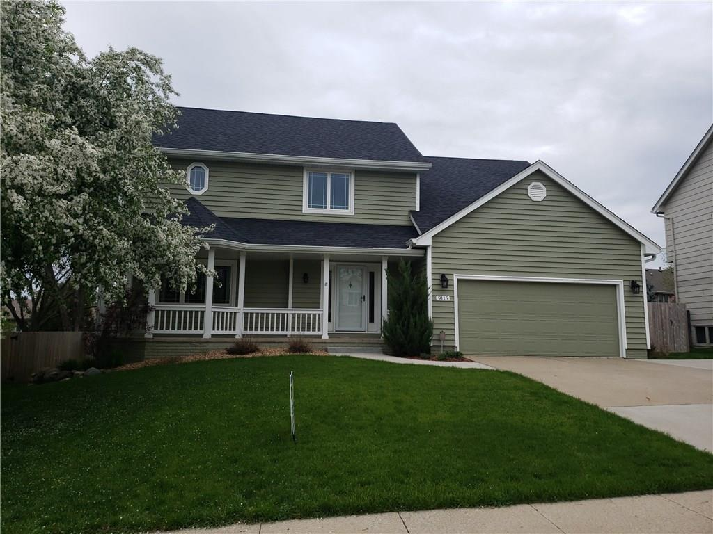Photo of home for sale at 9115 Tanglewood Drive, Urbandale IA